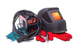 Inverter welding machine, welding equipment, isolated on a white background, welding mask, leather gloves, welding electrodes, high-voltage wires with clips, set of accessories for arc welding.